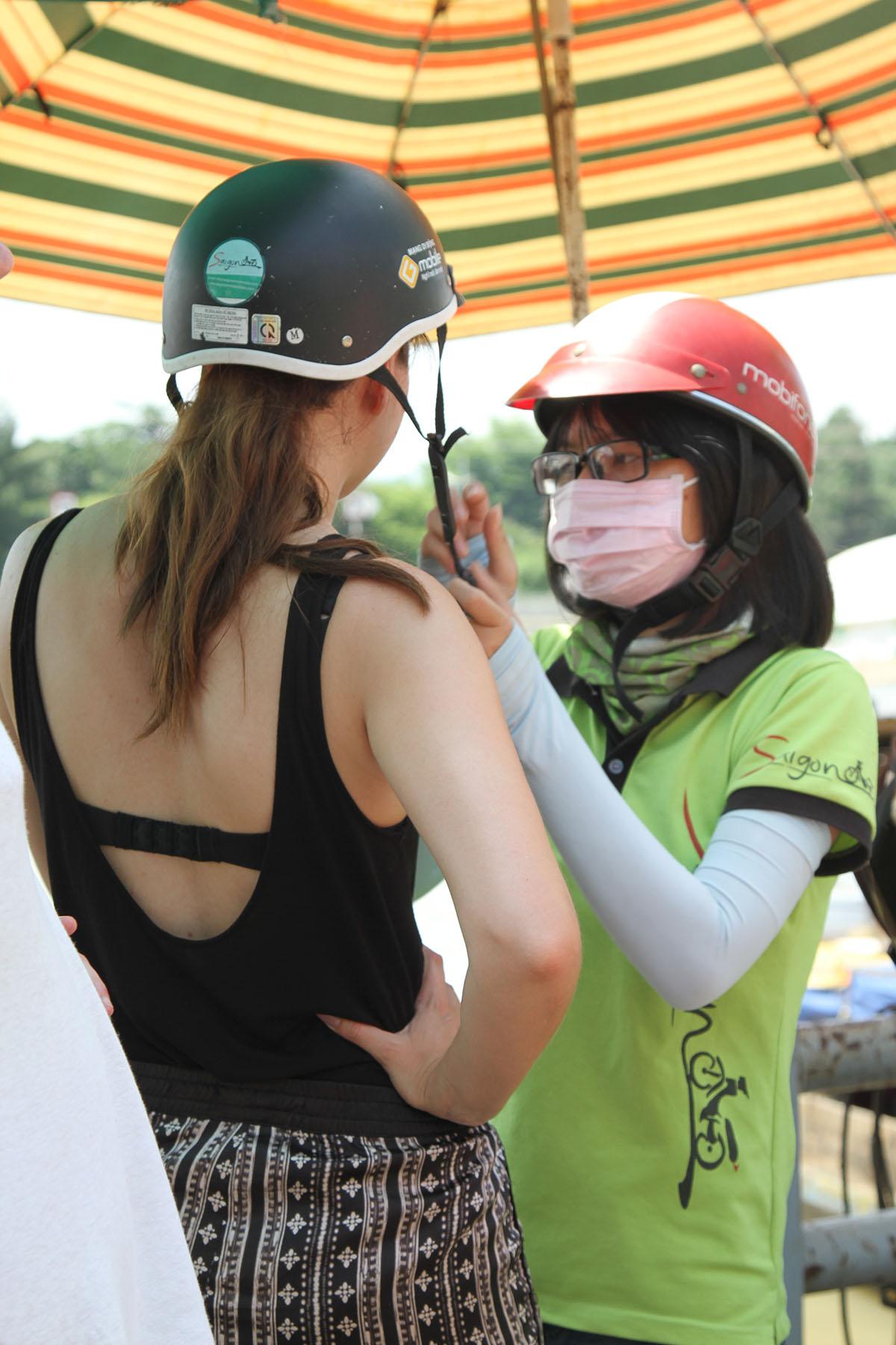 Saigon on motorbike supports tourists bring helmets.
